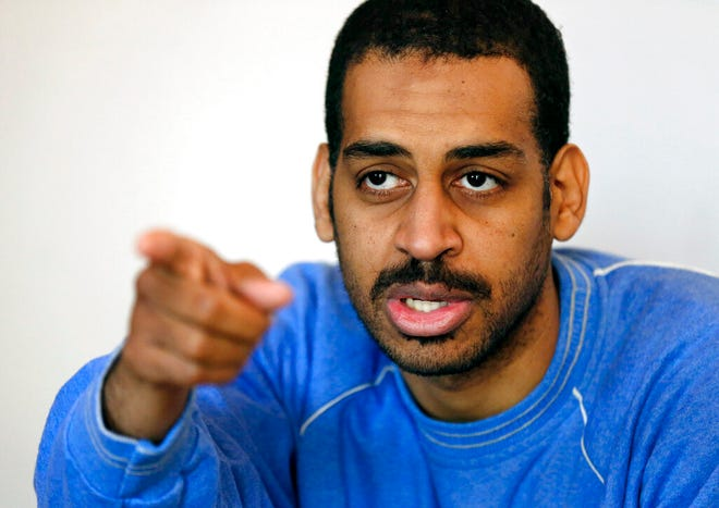 """In this Friday, March 30, 2018, file photo, Alexanda Amon Kotey, allegedly among four British jihadis who made up a brutal Islamic State cell dubbed """"The Beatles,"""" speaks during an interview with The Associated Press at a security center in Kobani, Syria. Kotey, one of two British nationals charged with joining with the Islamic State group and conspiring to torture and behead American and European hostages in Syria, is scheduled to plead guilty to criminal charges, Thursday, Sept. 2, 2021, in U.S. District Court in Alexandria, Va."""