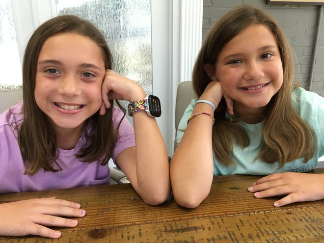 With the support of their families, L&E Properties, and the entire Mount Holly community, twin sisters Chloe (left) and Caitlyn Robinson raised more than $7,000 for the Backpack Weekend Food Program.