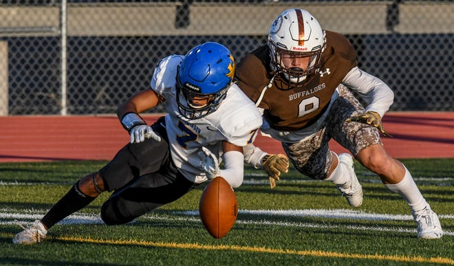 Garden City High School defensive back Cooper Ramsey, right, battles Hutchinson's Noah Khokhar for contol of a fumble off an errant Salthawks' pitch last seasonat Buffalo Stadium. Ramsey will be one of the defensive returning starters for the Buffaloes.