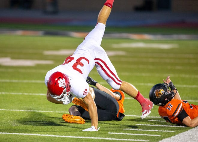 Glen Rose running back Tristan Black braces himself for the fall after being upended Friday night at Springtown.