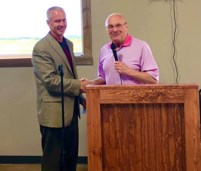 Glen Rose Lions Club member Larry Shaw, right, presents Glen Rose ISD Superintendent Dr. Trig Overbo with two $500 donations for the Glen Rose boys and girls basketball teams on Wednesday at The Rooster at Squaw Valley Golf Course. The Lions Club gives $20,000 annually to kids and school-related donations and over $35,000 in annual donations per year.