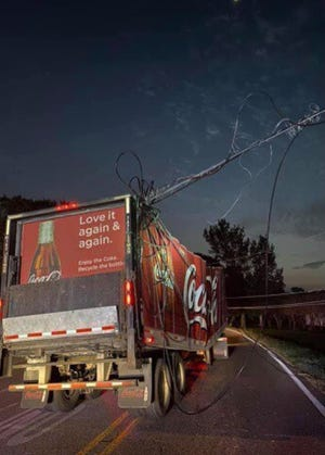 This Louisiana State Police photo shows a Coca-Cola truck that struck a power line in the Prairieville area.