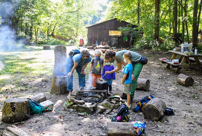 Chris Barth makes tea for the students at the Fairywood Forest School Thursday in western Brown County.