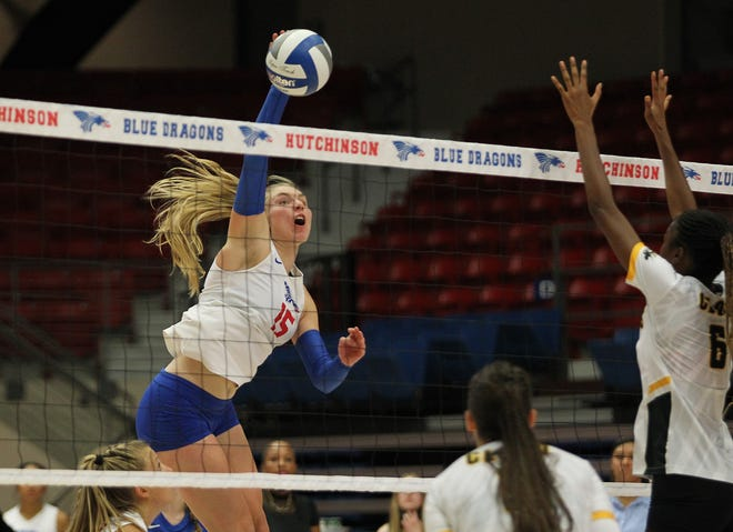 Hutchinson's Kristina Head (15) spikes the ball against Cloud County's Geraldyn Palacios (6) Wednesday at the Sports Arena. HCC beat Cloud County in five sets 3-2. (25-17, 25-15, 19-25, 15-25, 15-11).