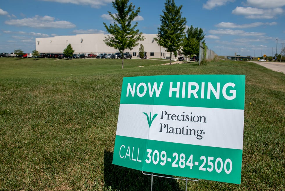 """A """"Now Hiring"""" sign is posted outside Precision Planting, 440 Erie Ave. in Morton. The agricultural equipment parts supplier is hiring for about 200 open positions."""