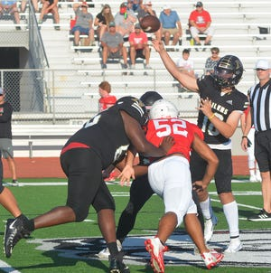 Newton sophomore Colby Gomez throws a pass during the pre-season jamboree Saturday at McPherson. Newton opens the season at 7 p.m. Friday at Andover Central.