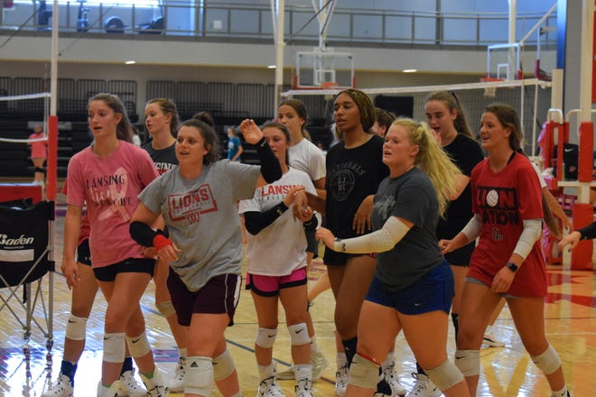 Shown is the Lansing varsity volleyball team following a drill at practice.