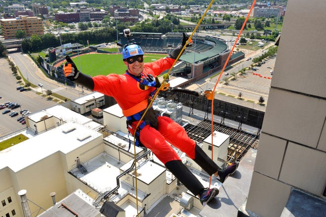Geoff Cook, aka Mr. Incredible, goes over the edge for Urban Scouting during the Seneca Waterways Council's 12th annual 21 Stories for Scouts at Kodak Tower. Cook attended the event as a representative of TAYLOR – The Builders.