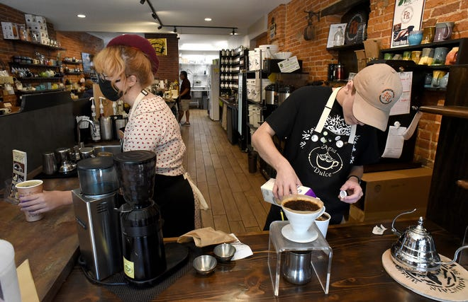 Aurora Reynolds, 19, a student at Monroe County Community College, and Grant Laroy, 20, a student University of Toledo, prepare drinks at Agua Dulce Coffee and Tea in downtown Monroe.