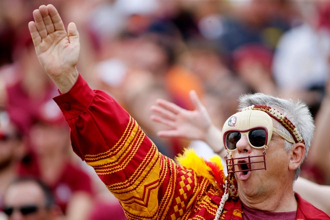 A Florida State Seminoles fan does the chop as Florida State hosts Syracuse at Doak Campbell Stadium.