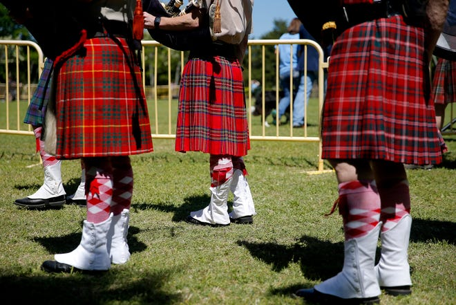 The Pipes and Drums of the Highlanders of Oklahoma City wait to perform during the 2019 opening ceremony for the Iron Thistle Scottish Festival in Yukon.