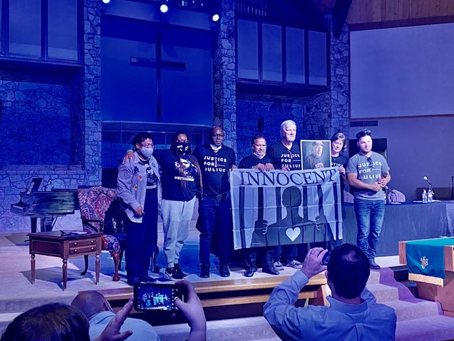 A group from the anti-death penalty nonprofit Witness to Innocence pose for a photo flanked by Madeline Davis-Jones, mother of Oklahoma death row inmate Julius Jones on the left and Gabriel Romo of Wisconsin on the right at the end of a presentation at Oklahoma City First Church of the Nazarene.