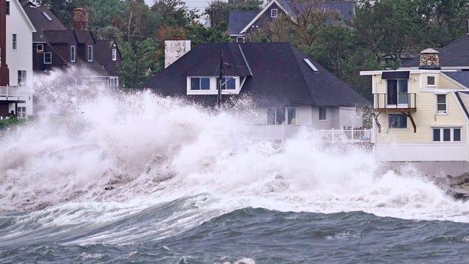 Waves slam along the Scituate shore near high tide as the remnants of Hurricane Ida leave coastal Massachusetts, Thursday, Sept. 2, 2021.