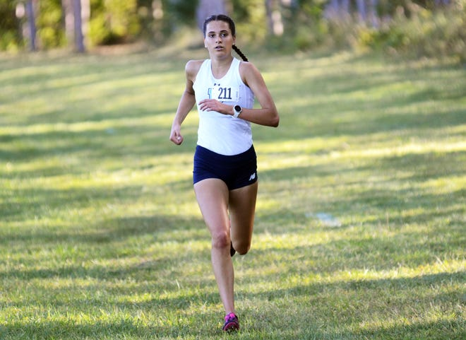 Petoskey's Noel VanderWall blew away the competition by over 30 seconds in East Jordan, finishing first overall in 18:50.30.