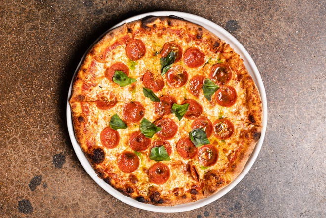 On the menu at Prezzo, an arrabbiata pizza is topped with Calabrian chili tomato sauce, pepperoni, mozzarella, basil and basil-infused extra-virgin olive oil.