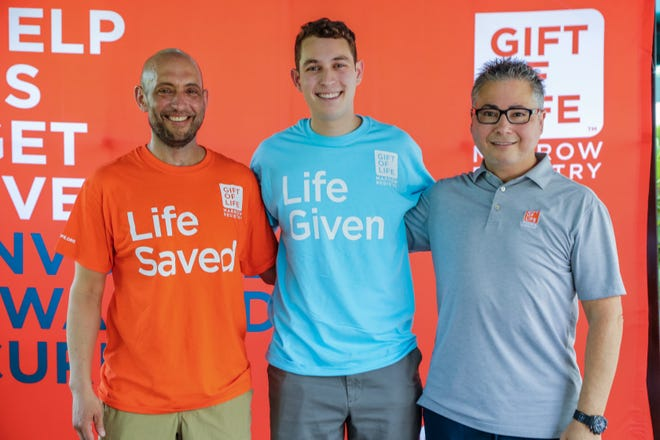 Stem cell transplant recipient Dave Fromson, from left, with his donor Josh Posner, and Gift of Life Founder & CEO Jay Feinberg, celebrate Gift of Life's 500th blood stem cell collection at its Boca Raton donation center.