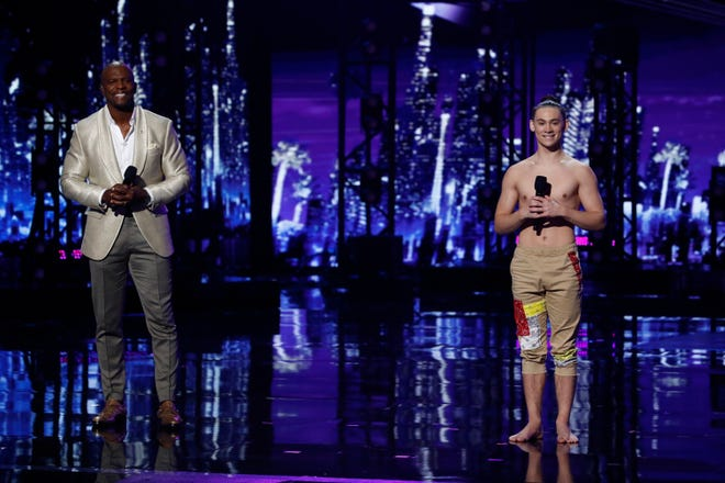 America's Got Talent Season 16 Host Terry Crews and contestant Aerialist Aidan Bryant on stage during the Semifinals.