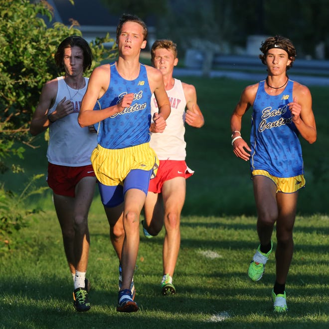 East Canton's Gabe Shilling (center) and Brylan Hollard (right) finished among the top six runners in the Division IIIA boys race at the Tiffin Cross Country Carnival.