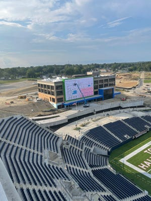 Work on the Constellation Center for Excellence is nearing completion, while construction crews clear the way for additional buildings in Hall of Fame Village powered by Johnson Controls. The office building sits on the west end of Tom Benson Hall of Fame Stadium.