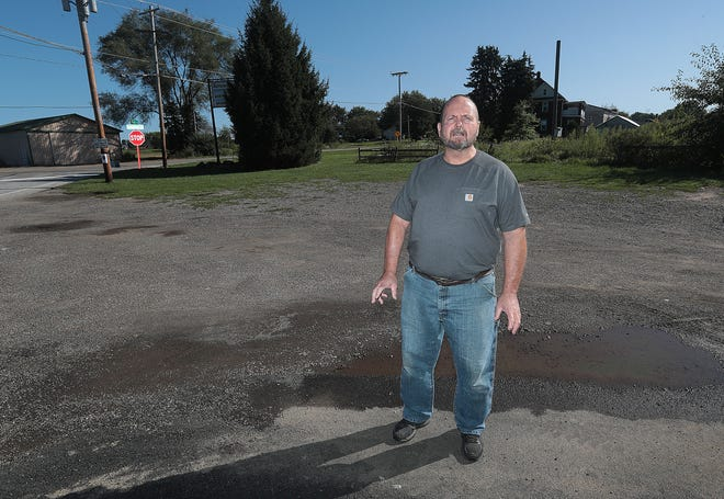 Nimishillen Township Trustee Donald Keefe stands at 5824 Columbus Road NE, site of a proposed Dollar General store.