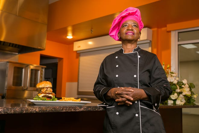 In late August, owner and chef Sandra Pearson opened Wammy's Kitchen, seen here on Thursday, Sept. 2, 2021, in Rockford. Next to Pearson on the counter is her signature Wammy's Gourmet Burger with Shrimp.