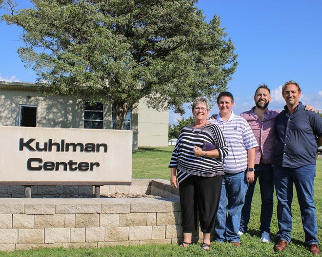 The Kuhlman Center at Kansas State University Salina was dedicated in honor of former longtime CEO and Dean Dennis Kuhlman. Attending were members of the Kuhlman family, from left: Carol, Breanna, Brock and Les.