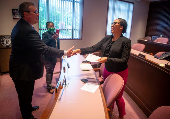 Capitol Township Trustees Lakeisha Purchase, right, is congratulated by Sangamon County Clerk Don Gray, left, after taking the oath of office in the Sangamon County Board Chamber at the Sangamon County Complex in Springfield, Ill., Monday, May 17, 2021. [Justin L. Fowler/The State Journal-Register]