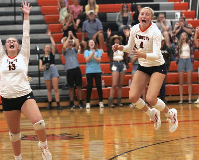 Sturgis' Jillian Romanyk (13) and Adison Nettleman (4) celebrate after the final point was scored Wednesday to give the Lady Trojans a sweep over Vicksburg.