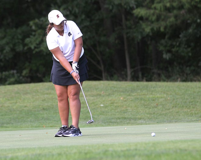 Citori Kosmerick of Sturgis sends a putt toward the hole on No. 2 at Island Hills on Wednesday.