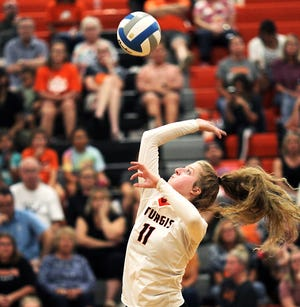 Juliette Schroeder rises up for a kill attempt against Vicksburg in prep volleyball action on Wednesday.