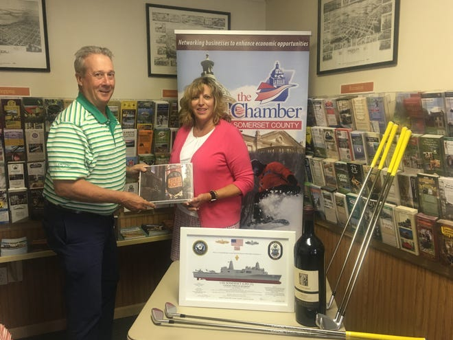 The annual Somerset County Chamber of Commerce golf event will be held Thursday at Hidden Valley Resort Golf Course. Pictured are Ron Aldom, chamber executive director and Deb Barron, vice president at NFP, which is sponsoring the Putting Contest at the event. This year there will be a definite winner on the putting, who will win a two-night package at the Priory Boutique Hotel in the historic Northside of Pittsburgh. Also pictured are a set of Bridgestone JGR Irons that will be awarded during the event. The new morning format will conclude with a heavy hors d'oeuvres reception where we will be hosting Capt. John Kurtz and other crew members of the USS Somerset. Registration is still open and sponsorships are still available.