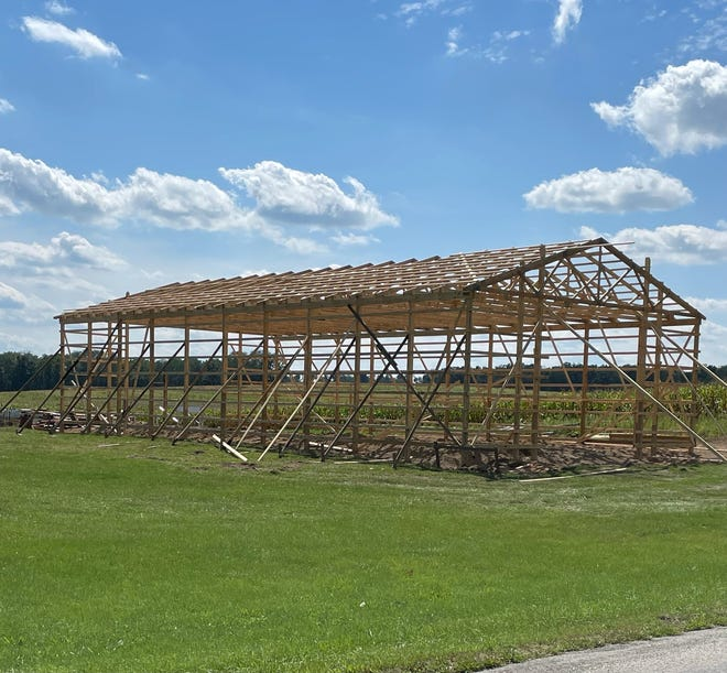 Men from the community gathered this week to work on Dustin's pole barn after the recent storm damage.