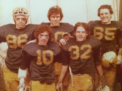 """""""Our colors are the Blue & Gold, our war cry M.H.S..."""" — the warriors who led our 1975 football team to glorious victory all year long! Back row left to right, (the late) Paul Coleman, Mark Burns, Jack Freker. Kneeling, Steve Carlin and Jeff Sullivan."""