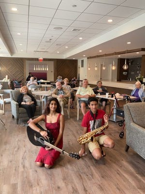 Needham High School students recently Nicky and Diya Thomason recently performed for residents at One Wingate Way, an independent senior living community in Needham.