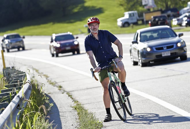 Jason Brozek of Appleton is working to improve bicycle safety on State 96 between Ballard Road in Appleton and Madison Street in Little Chute. He is pictured in Little Chute just yards away from the site of a 2016 bicycle crash that injured his son.