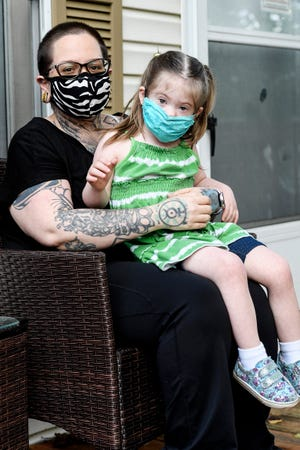 Tiffany Grzankowsi and her daughter, Phoenix Stone, 4, at their home in Arden, September 1, 2021.
