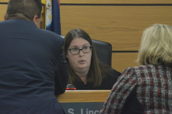 Circuit Judge Sarah Lincoln talks with attorneys during a bench conference Thursday.