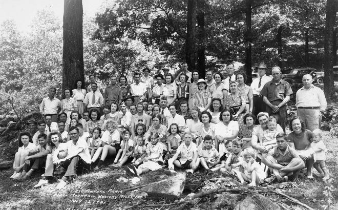 Employees of the Black Mountain Hosiery Mill pose at their first annual picnic at Mill Creek, 1941.