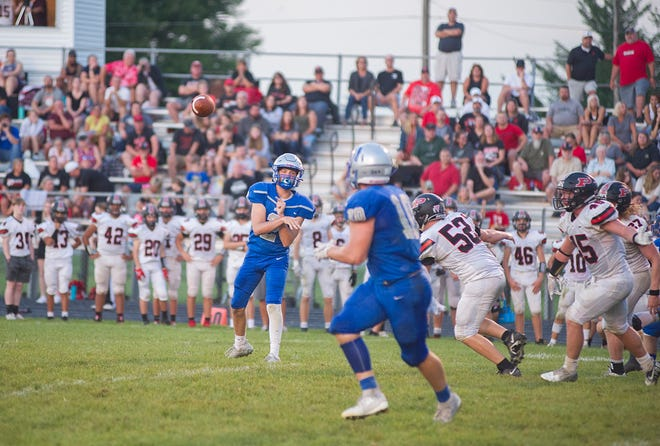 Wynford's Cobey Allen throws a pass to Kendall Blair.
