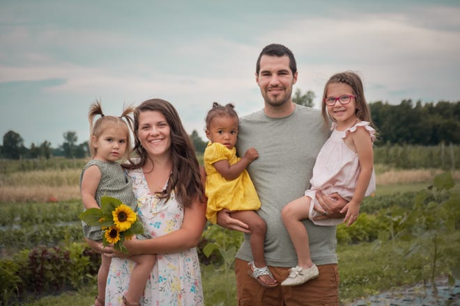 The Stuckey family includes, from left, Ruby, 2; mom Kelsey; Jaclyn, 1; dad Zach and Waylynn, 3.
