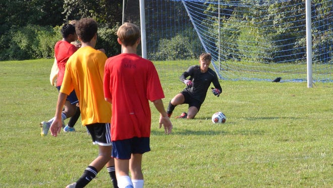 Bordentown goalkeeper Pim van Hilten ranges out to cover a rolling shot during a scrimmage at Moorestown Friends last Monday.