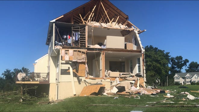 High winds Wednesday night tore off the back of this house off Joanne Court in the Willow Oaks development in Harrison Township. Owners and adjusters were estimating damage on Thursday.