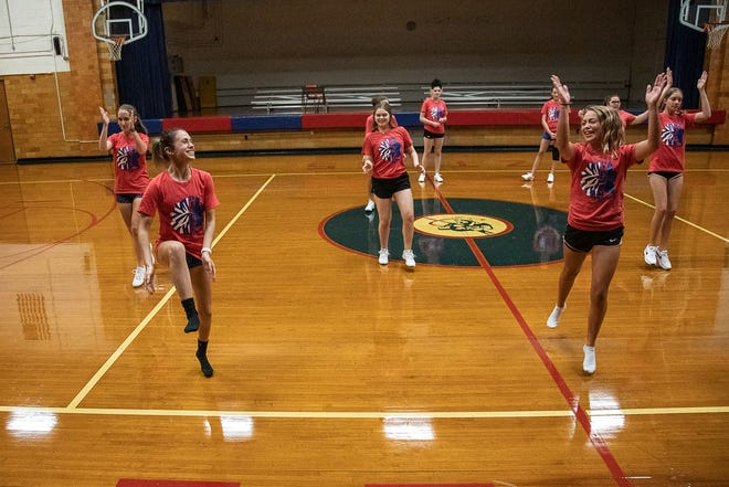 Zane Trace cheerleaders Cami Wilson and Karrah Johnson, front, warm up during cheer practice at Zane Trace High School earlier in the week. They are two of eight chosen to participate in the Citrus Bowl this holiday season.
