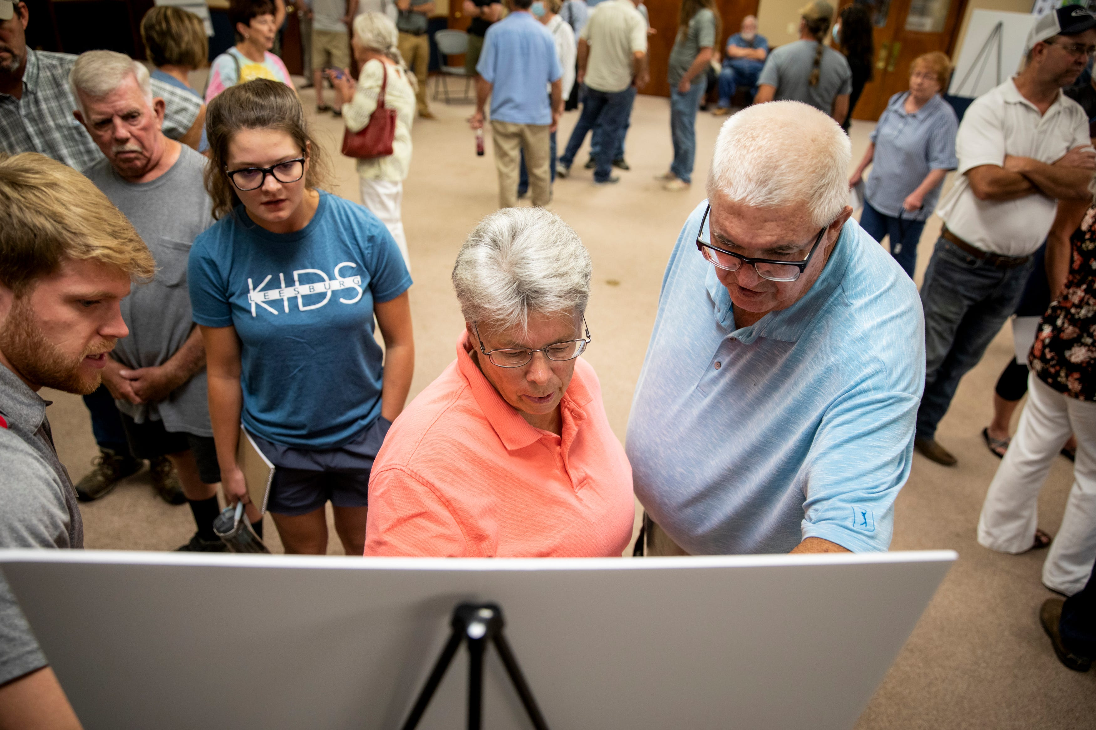 Pam McCauley shows reporter Lee Kendall of The Cynthiana Democrat where her farm is on a map in Cynthiana, Ky., on Wednesday, August 25, 2021.