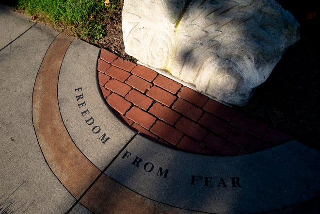 A view of one of several sculptures with inscriptions at Liberty Garden in Eden Park on Thursday, Sept. 2, 2021. The garden was designed by David Whittaker, partner of Human Nature, in 2002 to commemorate those lost in the September 11, 2001, terrorist attacks.