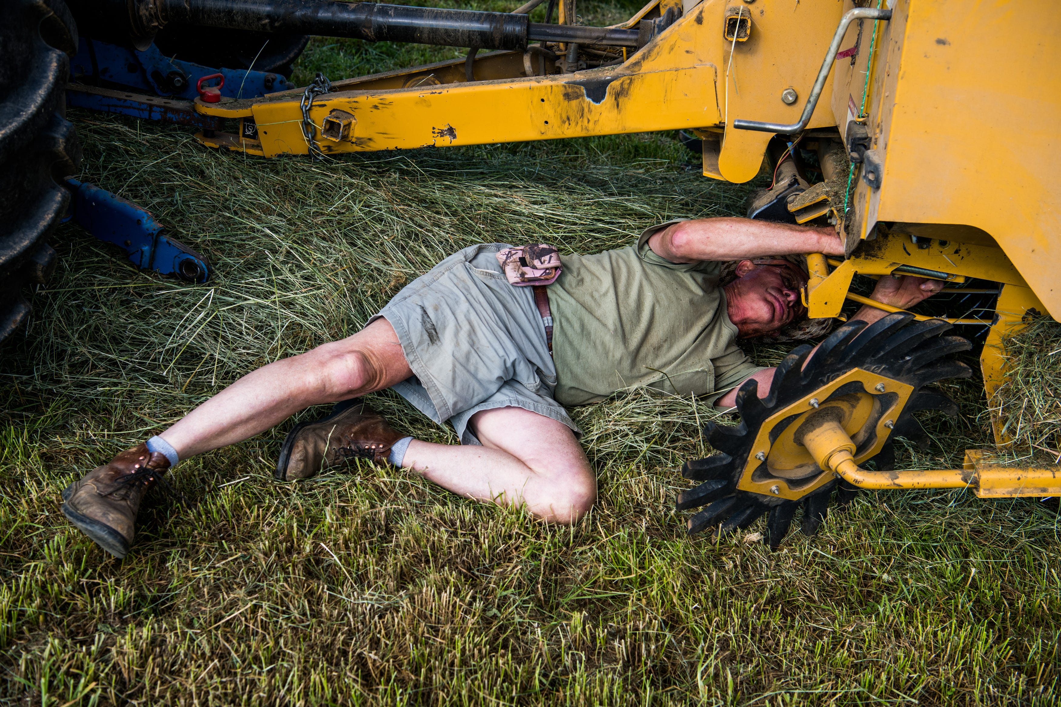 Wayne Clifford, 71, bales hay at his farm on Ruddles Mill Road in Harrison County, Ky. on Saturday, June 5, 2021.