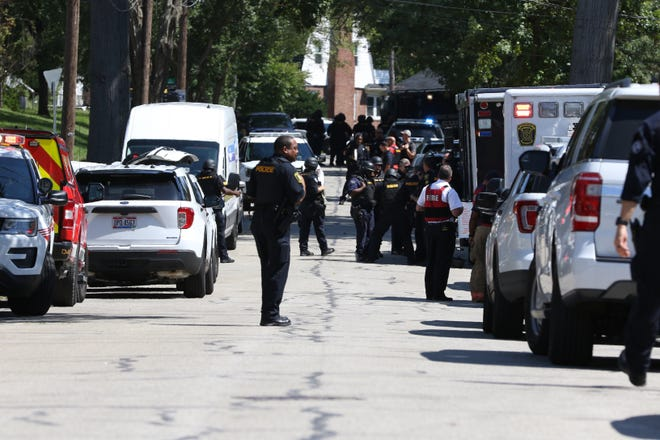 Police responded to Kennedy Heights Thursday to the report of a woman shot. The SWAT team responded when a suspect barricaded himself inside.