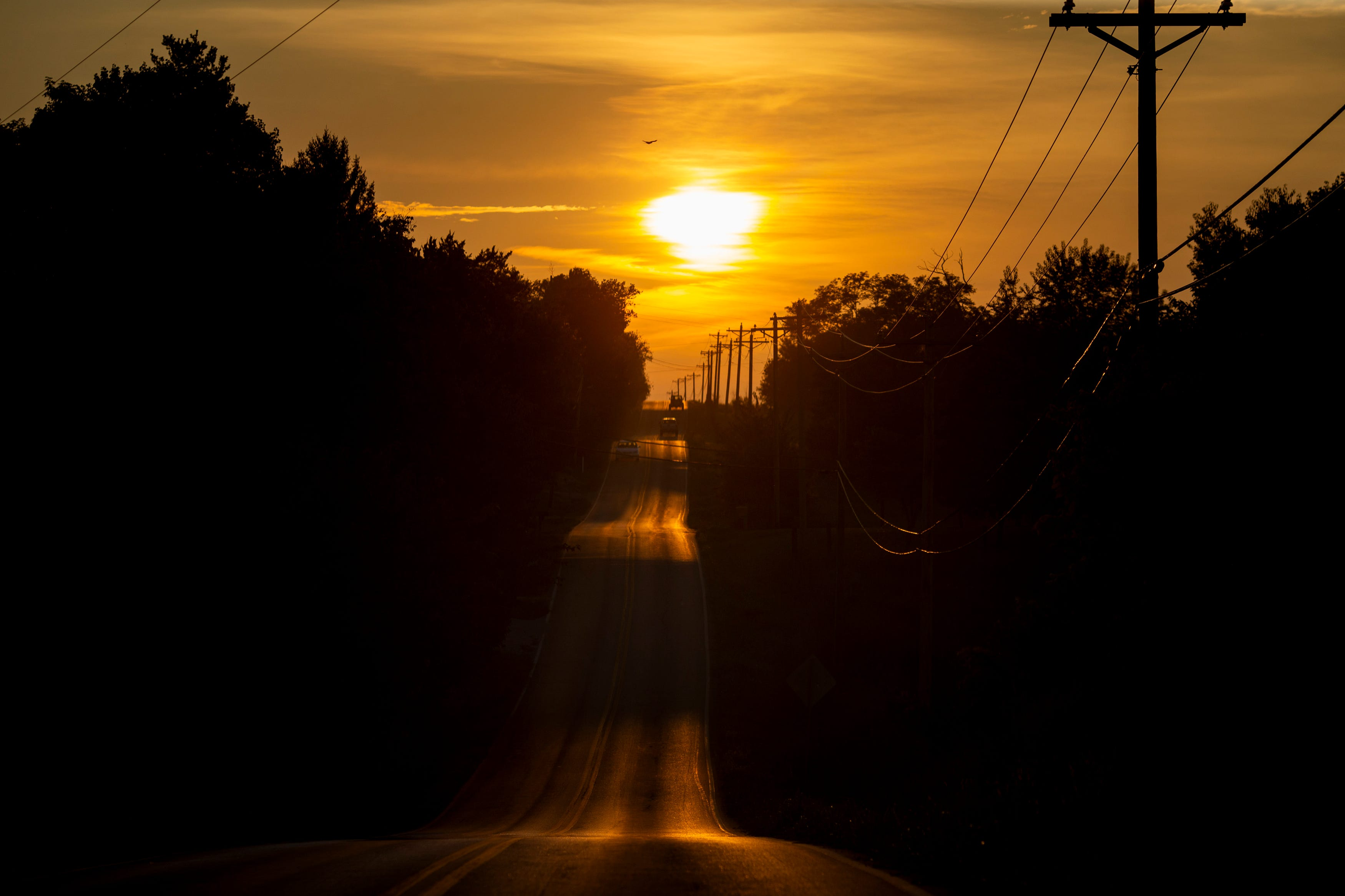 Vehicles travel in Harrison County, Ky., as the sun sets on Wednesday, August 25, 2021.