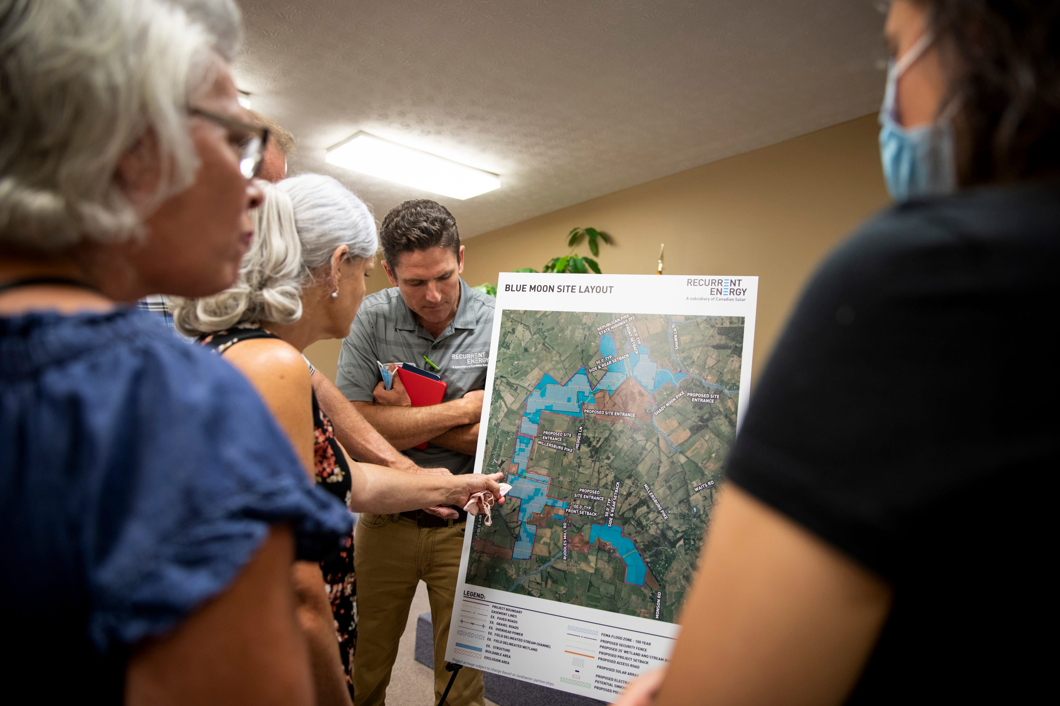 Community members ask questions about a proposed solar facility during a Recurrent Energy information session at the Harrison County Cooperative Extension Office in Cynthiana, Ky., on Wednesday, August 25, 2021.