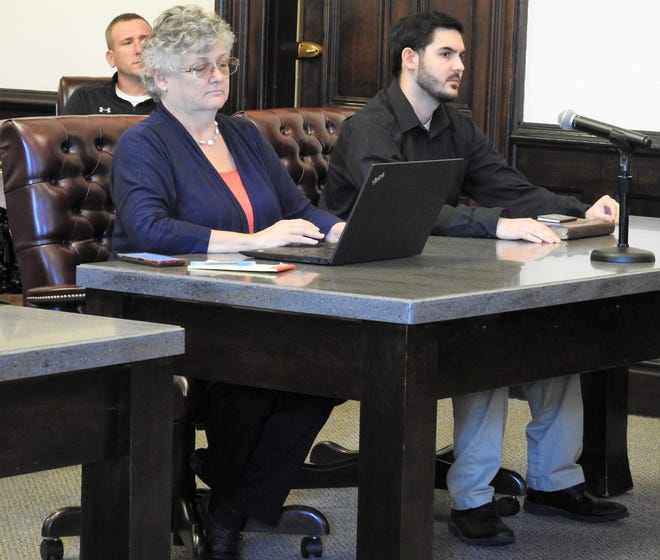 Attorney Marie Seiber with client Jordan Larntz Thursday in Coshocton County Common Pleas Court. He was sentenced to an indefinite term of 3 to 4.5 years in prison for the attempted armed robbery of a gas station on New Year's Day.